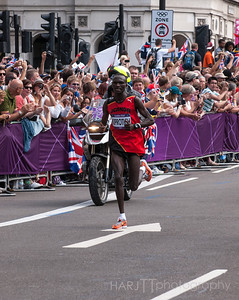 "Mens Marathon London 2012 Olympics Stephen Kiprotich - Race Leader and winner of the Mens Olympic Marathon on the last short stretch of the 3rd laptop and onto the winning line on ""The Mall"".  Olympus E3"