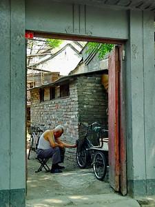 Repairing a bicycle, Beijing