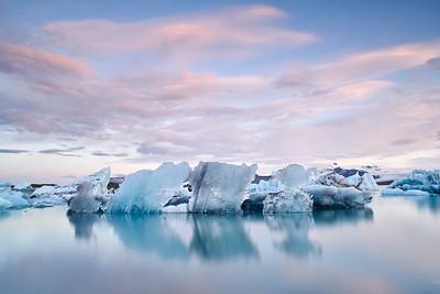 The mesmerising icebergs in Jokulsarlon's Glacier Lagoon in the very early morning. Vatnajokull National Park, Iceland