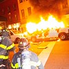 NEW YORK - May 30, 2020: for NEWS. FDNY firemen work to put out ignited police vans during riots against the NYPD in Manhattan after protests against the police involved death of George Floyd in Minneapolis turned violent amid the COVID-19 coronavirus pandemic.  nypostinhouse (Photo by: Taidgh Barron/NY Post)