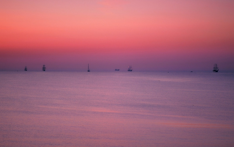 Shot right before sunrise in 1976. These were the tall ships that came to Boston for the 200th birthday bash. Shot on slide film from the beach in Marblehead.