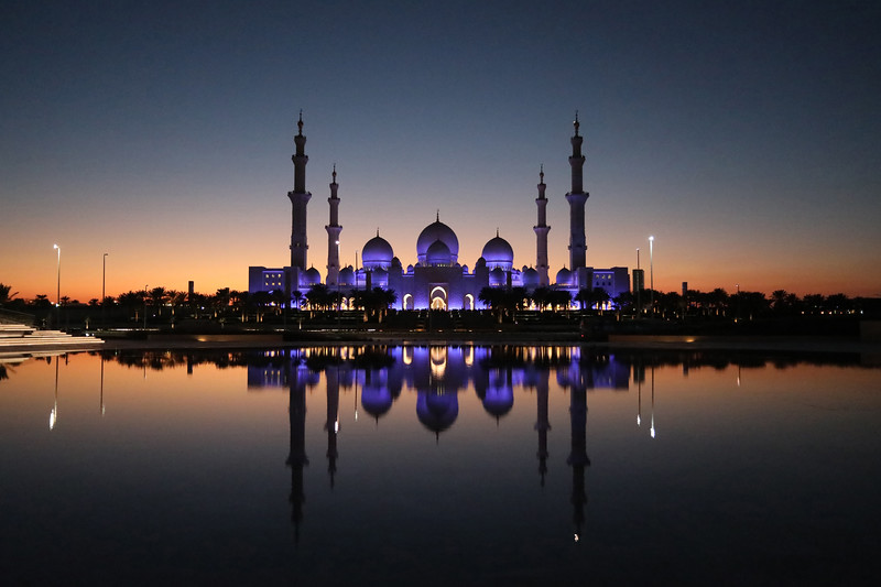 Sheikh Zayed Grand Mosque in Abu Dhabi, UAE, is lit up at dusk on 12 January 2018. The mosque's architecture combines Mamluk, Ottoman and Fatimid styles and is the largest in the country.