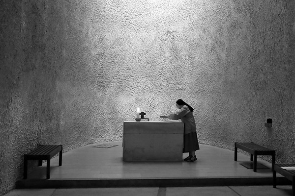 A nun at an alter inside the Notre Dame du Haut chapel in Ronchamp, France, designed by architect Le Corbusier. The chapel is on the UNESCO World Heritage List.