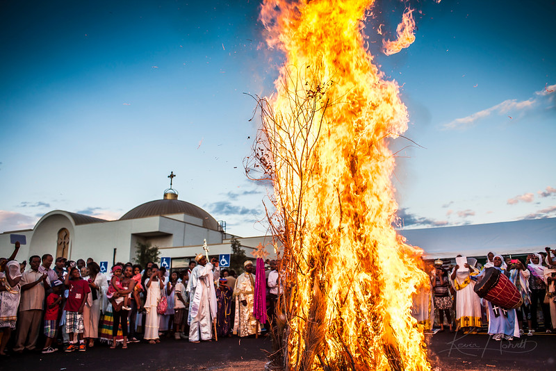 AURORA - Members of Gishen Mariam Church, one of Colorado's largest Ethiopian Orthodox congregations, light a bonfire for the annual Meskel celebration. Meskel is known as the finding of the true cross.