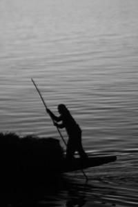 A man punts a boat along the river Bani near Mopti, Mali