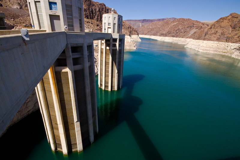 Two of the four reinforced-concrete intake towers above the dam—on each side of the canyon and consequently in different states—provide water to turn the power plant turbines. Nevada Side.