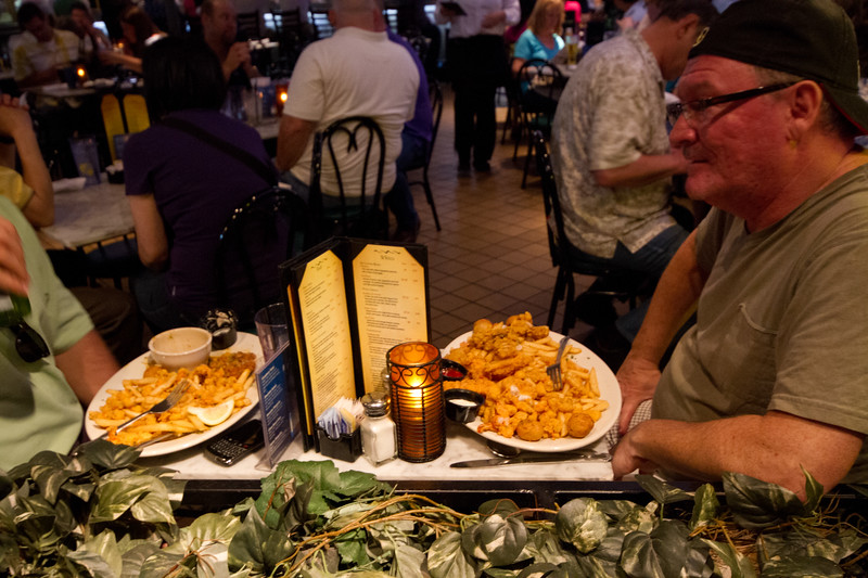 Dining at a Bourbon Street sidewalk window table, we asked the fellow on the right if we could shoot him struggling with a huge seafood combo. He obliged. As much as New Orleans is about the people, New Orleans is also... well how about the entire region.., is also about the best food, the best drink and the best party ever!  Bon Appètit (and Drink!)