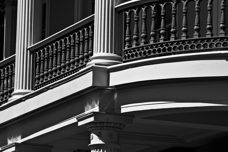 (Unframed Version) Timeless Symmetry, Upper Portico - Garden District, New Orleans - Just a short ride from Canal Street on the St Charles Cable Car Line towards Carrollton one finds themselves in the Garden District..  Home to celebrity the likes of Payton Manning, Ann Rice, Nicholas Cage and a host of other well-to-do New Orleans notables for over 150 years, this ten-block long neighborhood situated between the Mississippi and St Charles Street is a must-do stroll on any given day.. The Lafayette Cemetery lies mid-point and every street is lined with color and all the popular architectural style of the 19th Century..