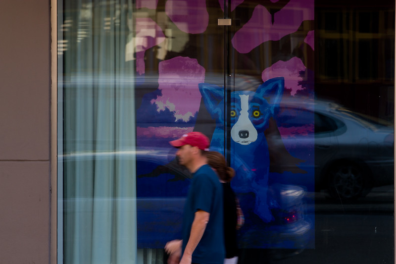 """Unframed Version<br /> <br /> May 17, 2012 - 'Urban Blur & Blue Dog'  - Reflections of Canal Street - New Orleans, Louisiana<br /> <br /> In a hurry?  Slow down and really experience the Big easy...<br /> By the way, check out artist George Rodrique here for more on the Blue Dog:<br /> <a href=""""http://www.georgerodrigue.com/rodrigue/index2.htm"""">http://www.georgerodrigue.com/rodrigue/index2.htm</a><br /> <br /> Thanks,  HB"""