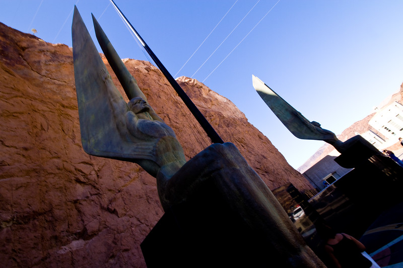 """Two 30-foot tall bronze sculptures - """"winged figures"""" - by Oskar Hansen symbolize """"the immutable calm of intellectual resolution, and the enormous power of trained physical strength, equally enthroned in placid triumph of scientific achievement."""""""