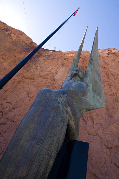 "One of two 30-foot tall bronze sculptures - ""winged figures"" - by Oskar Hansen symbolize ""the immutable calm of intellectual resolution, and the enormous power of trained physical strength, equally enthroned in placid triumph of scientific achievement."""