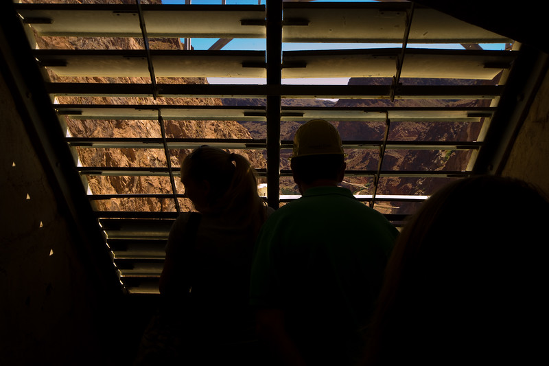 Tourists peer from behind louvered grating - approximately 350 feet above the Generator house.