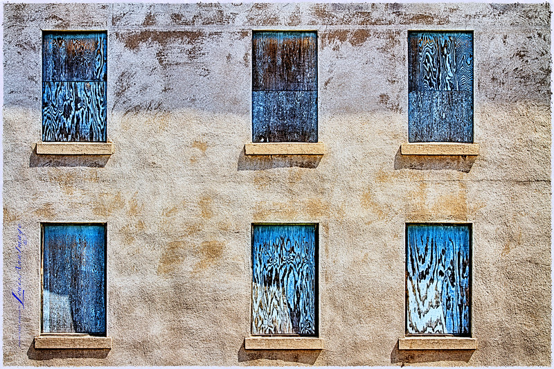"'All  Boarded Up...'<br /> A 'minimalist' piece - the textures & symmetry of old stucco and boarded windows screamed ""shoot me!!"" - 500 Hull Avenue, Jerome, AZ - Not much info on the building available but some references to it being ""Historic Hotel Jerome"" at one time..  The Jerome Artists Cooperative Gallery occupies most of the bottom floor street side.  Three exposure compilation, Canon 7D, 1/250 s, 1/125 s, 1/60 s @ f/9.0, ISO 100, EF70-200mm f/2.8L IS II USM @ 70mm, NIK HDR Efex Pro 2 - Custom Profile, NIK Color Efex Pro 4 - Tonal Contrast, Polaroid Transfer - for ragged border effect, Viviza - Structure, Hue, Red, Blue & Green to undo Polaroid Transfer saturation shift."