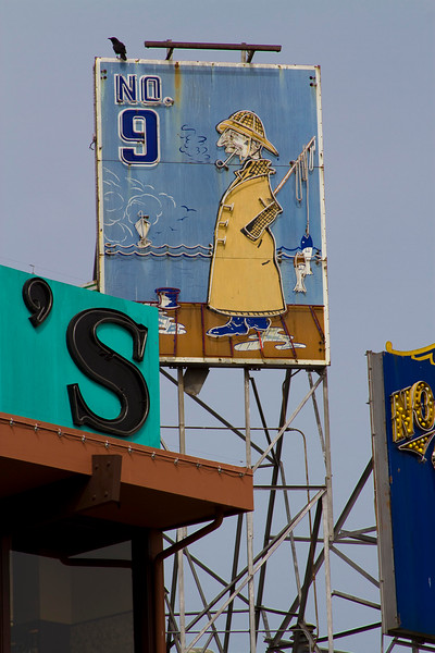 Whimsical signs announce each merchant and restaurant along the waterfront - Fisherman's Wharf, San Francisco