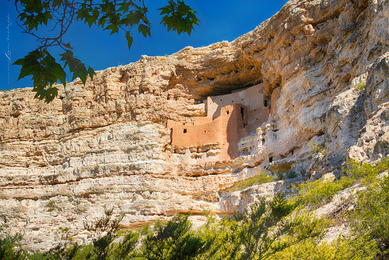 """'Montezuma's Castle...' <br /> Really a must-see while in the Sedona area, this easy-to-access, native American wonder was so worth the side-trip.<br />  About a half hour south of Sedona near Camp Verde, along Bever Creek, this National Monument (since 1906) is one of the best preserved Cliff Dwellings in North America.  Built and used by the Pre-Columbian Sinagua people, It was occupied from approximately 1100-1425 AD, it's occupation peaking around 1300 AD. A sofisticated complex, the structure comprises 20 rooms on 5 levels (floors) and was likely occupied by about 50 people. Carved in the limestone cliff, the Sinagua were courageous builders - using primative tools  for construction and accessing the entire site by ladders. We really do not know exactly why the Sinagua abandoned the complex, but their ancestors still live in the region.  Several Hopi Clans trace their roots to the Sinagua and the Beaver Creek area. Neither part of the monument's name is correct. The Sinaqua dwelling was abandoned 100 years before Montezuma was born and the Dwellings were not a castle. It was more like a """"prehistoric high rise apartment complex"""".  ~ Paraphrased from Wikipedia<br /> A three exposure HDR, 1/800s, 1/400 s, 1/200 s, ISO 100, f/9, EF24-70mm f/2.8L II USM @ 26 mm"""