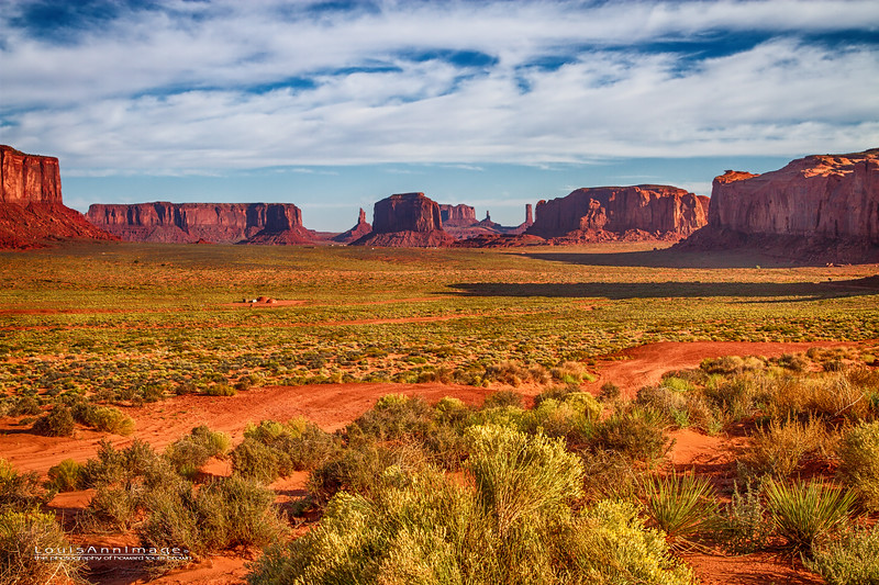Morning in the Monument Valley -  A tribal residence or 'Hogan' can be seen in the mid-left part of the image. Yes, many Navajo cling to their ancestral roots, living right where countless generations have..  How's this for your front porch view?  Canon 7D, EF24-70mm f/2.8L II USM @ f/9, 1/250 s, ISO 100