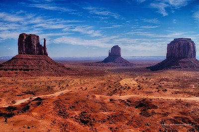 "To the left - West Mitten Butte, Middle - East Mitten Bute, Left - Merrick Butte - Monument Valley, Navajo Tribal Park, AZ Three Exposure HDR See More of Arizona & Utah - ""The Southwestern Sun' here: http://smu.gs/RfQCCf"
