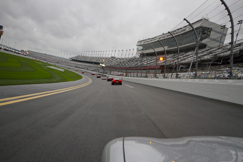 From my view - heading into the tri-oval - Rain wet track - maybe only 45 MPH!?!  Parade Laps.  The Rolex Series Opener Week - Captured on Friday Jan 27. Rainy Day. Daytona International Speedway -