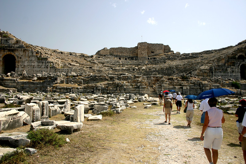 Tourists wonder among the ruins of the Theater of Miletus, Turkey