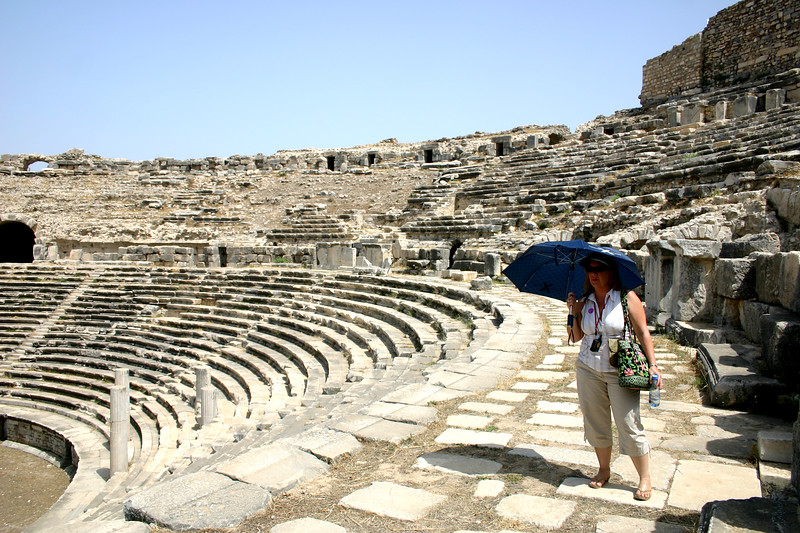 The umbrella guards aganst 110 degree sun among the ruins of the Theater of Miletus, Turkey