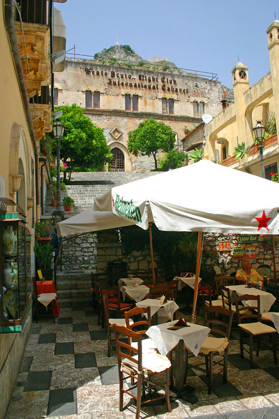 Cafe - Taormina, Sicily - A mountainside city set intentionally on the cliffs to allow its inhabitants to defend themselves from ancient invaders, the streets of Taormina are as picturesque as any in Europe.