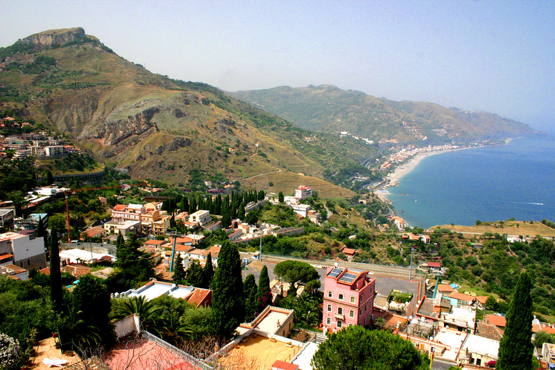 Coastline toward Messina - from behind the amphitheatre - A mountainside city set intentionally on the cliffs to allow its inhabitants to defend themselves from ancient invaders, the streets of Taormina are as picturesque as any in Europe.
