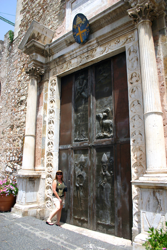 A massive cathedral door - Taormina, Sicily - A mountainside city set intentionally on the cliffs to allow its inhabitants to defend themselves from ancient invaders, the streets of Taormina are as picturesque as any in the Mediterranean.