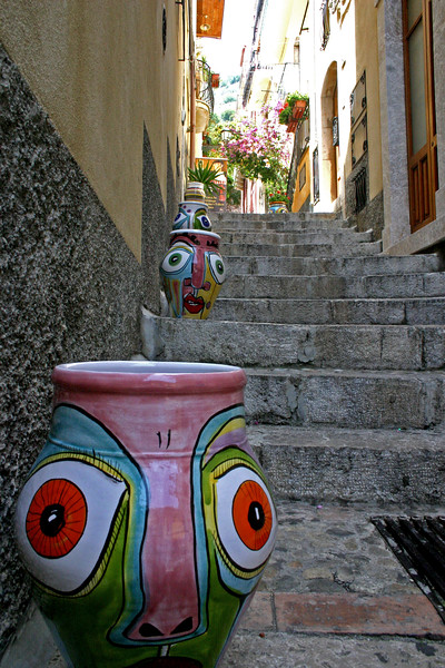Alleyway - Taormina, Sicily - A mountainside city set intentionally on the cliffs to allow its inhabitants to defend themselves from ancient invaders, the streets of Taormina are as picturesque as any in Europe.