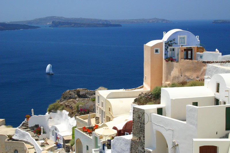 for 5-23-10 - Santorini - a delightful mosaic of color, colorless white, and volcanic earth contrasting the dueling azure blue of sky and sea.  A photographers paradise!