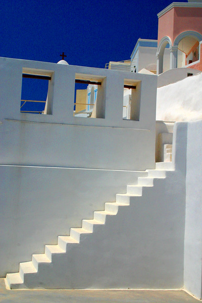 Santorini - a delightful mosaic of color, colorless white, and volcanic earth contrasting the dueling azure blue of sky and sea.  A photographers paradise!