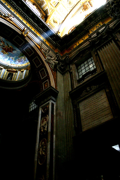 As if a divine sign, rays of the sun penetrate the vast space inside Saint Peter's Basilica, Vatican, Rome Views from the Vatican Museum and St Peter's Basilica, Vatican City, Rome, Italy