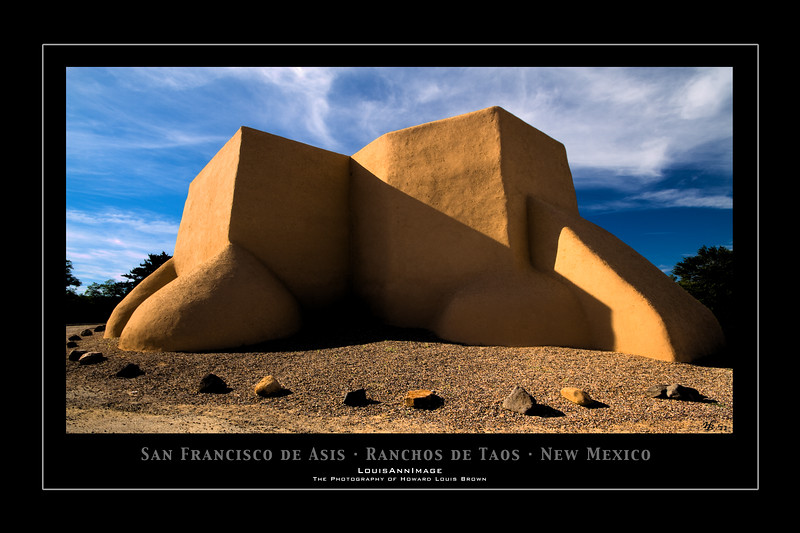 "September 25, 2011 - Not to be undone by the lurking thumbs-down snake, here's my post for today - Thanks to all who commented or emailed me yesterday in support of efforts to expose this problem. We will overcome.    Now, continuing our journey in New Mexico.. <br /> <br /> You may wonder just what this building is.. Actually this is the rear of the San Francisco de Asis Church - I felt honored to have been able to photograph this wonderful place of worship - so steeped in heritage, so long in existence, so well built and so simply beautiful and purposeful in design.  <br /> <br /> Here's more - (The following is from Wikipedia): ""San Francisco de Asis Mission Church is a church built between 1772 and 1816. It is located on the plaza in Ranchos de Taos, itself a historic district named Ranchos de Taos Plaza, about four miles southwest of the town of Taos, New Mexico. Construction on the church began around 1772 and was completed in 1815 by Franciscan Fathers and its patron is Saint Francis of Assisi. It is made of adobe as are many of the Spanish missions in New Mexico. It is located a few miles south of Taos Pueblo and has inspired among the greatest number of depictions of any building in the United States. It was the subject of four paintings by Georgia O'Keeffe, and photographs by Ansel Adams and Paul Strand. Georgia O'Keeffe described it as, ""one of the most beautiful buildings left in the United States by the early Spaniards."" It was declared a National Historic Landmark in 1970. It is also designated as a World Heritage church.""<br /> <br /> The front of the church and it's courtyard faces southward and is opposite this view - it's much more typical of Spanish church design of the late 1700's in the Southwest.  The Northern elevation however accentuates the bulbous buttressing of adobe - essentially dried clay reinforced with straw... necessary to support the interior height of the sanctuary.  Ingenious!  With this design, light and shadow play wonderfully in the mind of the painter and photographer.  And as such, like Wikipedia mentions, this place has been well looked upon by generations of us - seeking our own rendering of it's beauty.  To have stood where the likes of Ansel Adams, Paul Strand and Georgia O'Keeffe did and compose my own image was pretty special.<br /> <br /> HB"