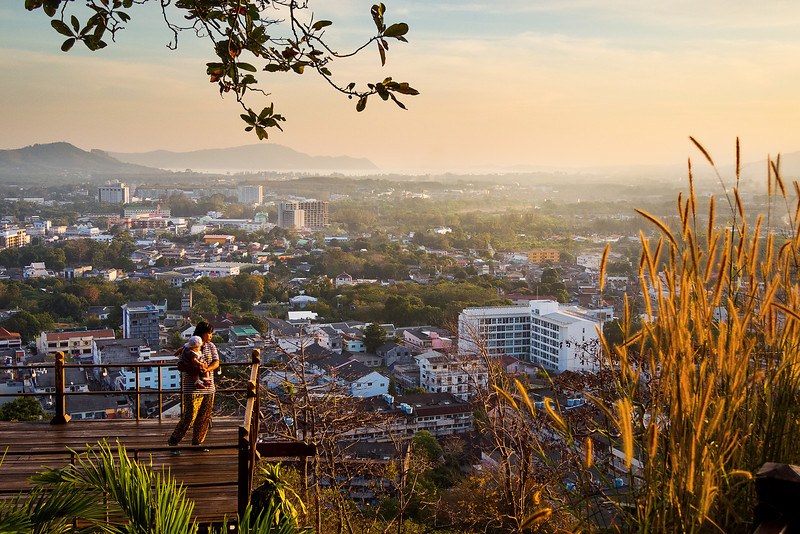 Woman with child overlooking Phuket Town. Phuket, Thailand