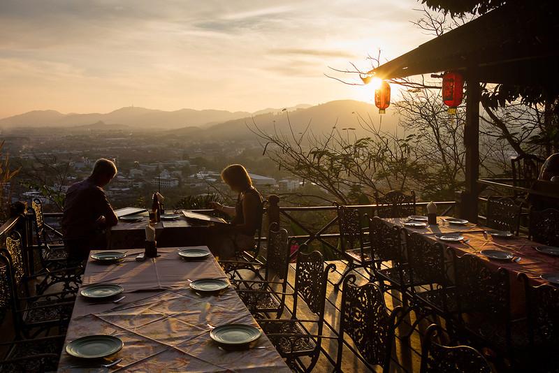 Couple Dining in Restaurant at Rang Hill (Khao Rang). Phuket, Thailand