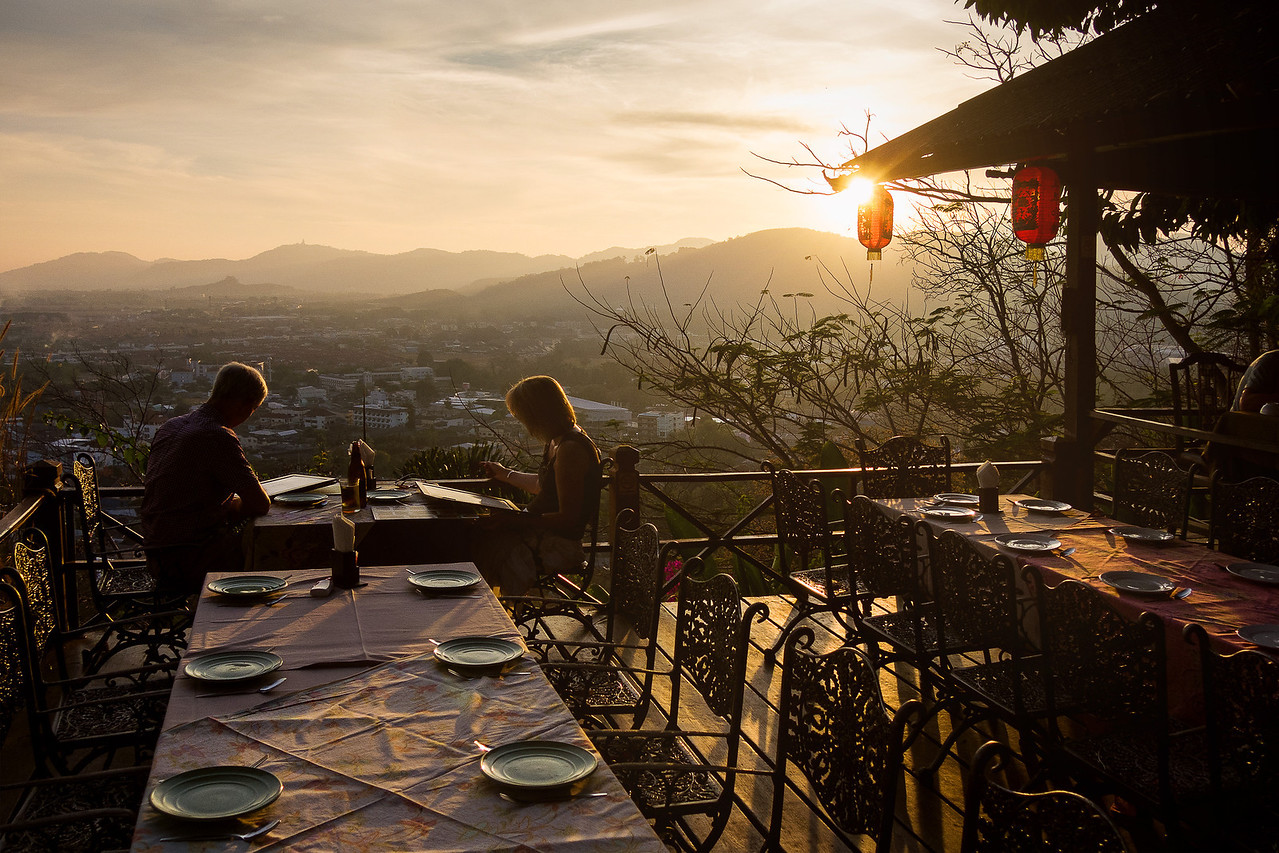 Couple Dining in Restaurant at Rang Hill (Khao Rang). Phuket, Thailand