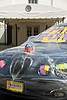 """White House staff decorated Carl Rove's Jaguar with saran wrap, stuffed animals, sticky notes, and bumper stickers that read """"I love Obama – Barack Obama for President."""" They pulled off the prank while Rove was travelling with the president, leaving his car parked across from the West Wing entrance (visible in background)."""