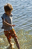 Bennah splashes through the water along the shore at Mason Neck State Park in Northern Virginia.