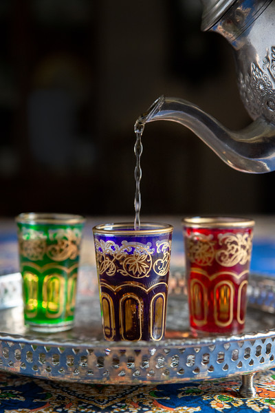 Moroccan Tea being poured into glasses.