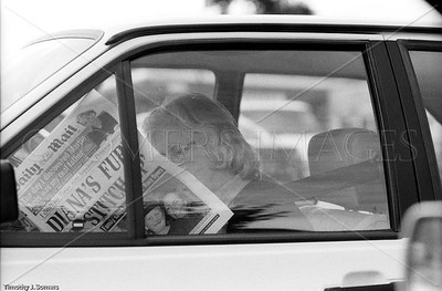 Woman reading Daily Mail, London, England, 21 August, 1997, the day Princess Diana was killed In Paris.
