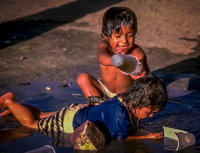 Happy Niños play on the Malecon, La Paz, Baja California Sur, Mexico