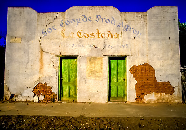 ¡dos puertas verdes! Headed south down Baja California's Highway 1… I slammed on the brakes The two green doors had pulled me in I have been by them many times before I always wondered where they went? An agricultural cooperative building,  the exposed adobe bricks  and earthquake sized cracks boast incredible texture! Located just 50 miles south of Ensenada in the valley of Santo Tomas,  this building today is an ice cream store in Mexico's most noteworthy wine region.