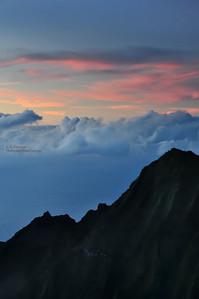 Wonderful sunset viewed from Waimea Canyon looking toward the Na Pali Coast