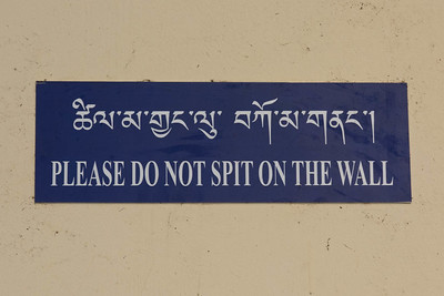 Sign on wall in food market in Thimpu, Bhutan