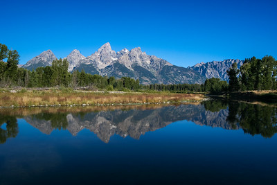 Reflection of Grand Tetons off Snake River in Wyoming.