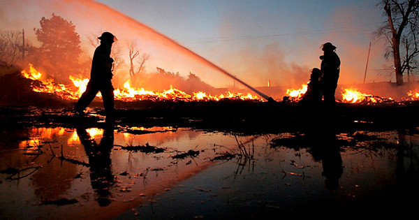 As dawn breaks on Friday, area rural firefighters continue to battle a fire that started about 2 a.m. About an acre of railroad ties about a half-story tall behind the Edge Bar and Grill at 5074 W. Highway 30 east of Alda burned throughout the night. Along with the Alda and Grand Island Rural fire departments, units from Doniphan, Wood River, Cairo and St. Libory were called to the scene to help contain the blaze.