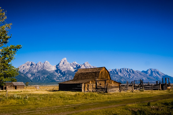 House on Mormons Row with Grand Tetons in the background in Wyoming