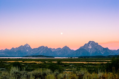 Grand Tetons with Moon setting over Mount Moran in Wyoming