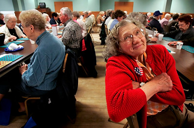 As other seniors play bingo around her during Wednesday's Community Unity Senior Expo, Norma Janko remembers playing music with her husband, George Janko, who still plays in the Lyle Hulinsky Band. the band played during the expo at the Platt-Duetsche in Grand Island.