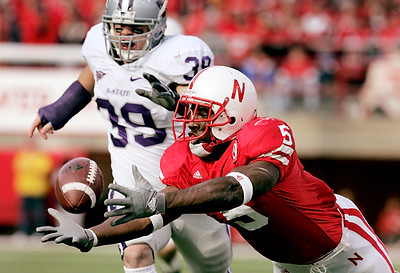 Nebraska's Marlon Lucky stretches out for a third-quarter pass only to come up short after beating John Houlik of Kansas State. Lucky ran for 103 yards and another 78 yards receiving.
