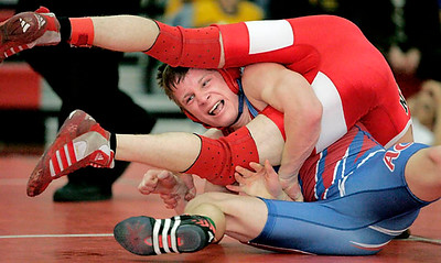 Adam Central's Ben Jones (right) fights back to tie his B-3 district 119-pound championship match with Nicholas Mosher of Broken Bow just before the end of the third period. Unfortunately, Jones lost the match to Mosher shortly into the fourth period in front of a home crowd, 10-8.